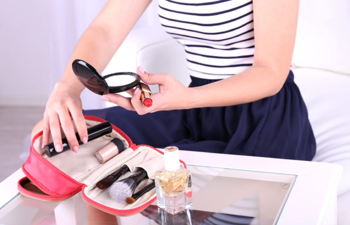 girl taking makeup from her case