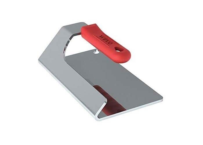 chrome-colored rectangular grill press with an angled handle with a red rubber grip