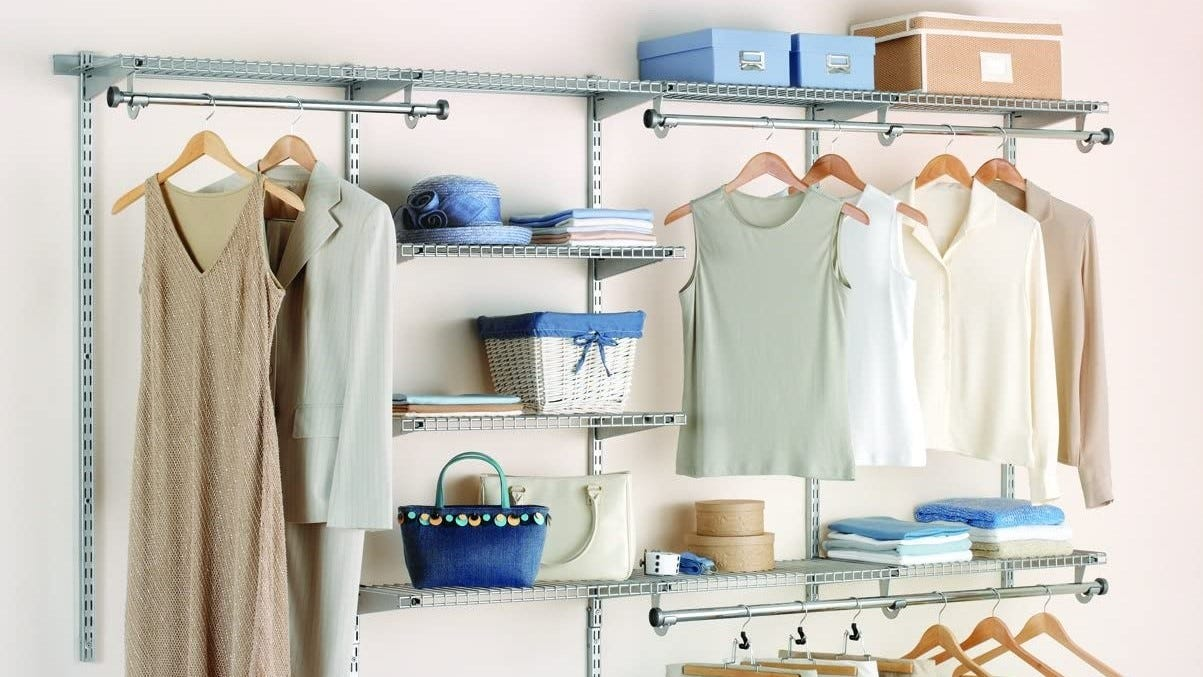 Rubbermaid closet organizer filled with clothing and accessories.