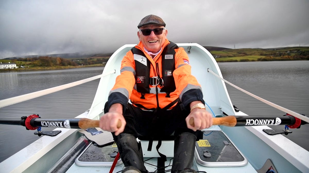 Frank Rothwell sitting in a rowboat.