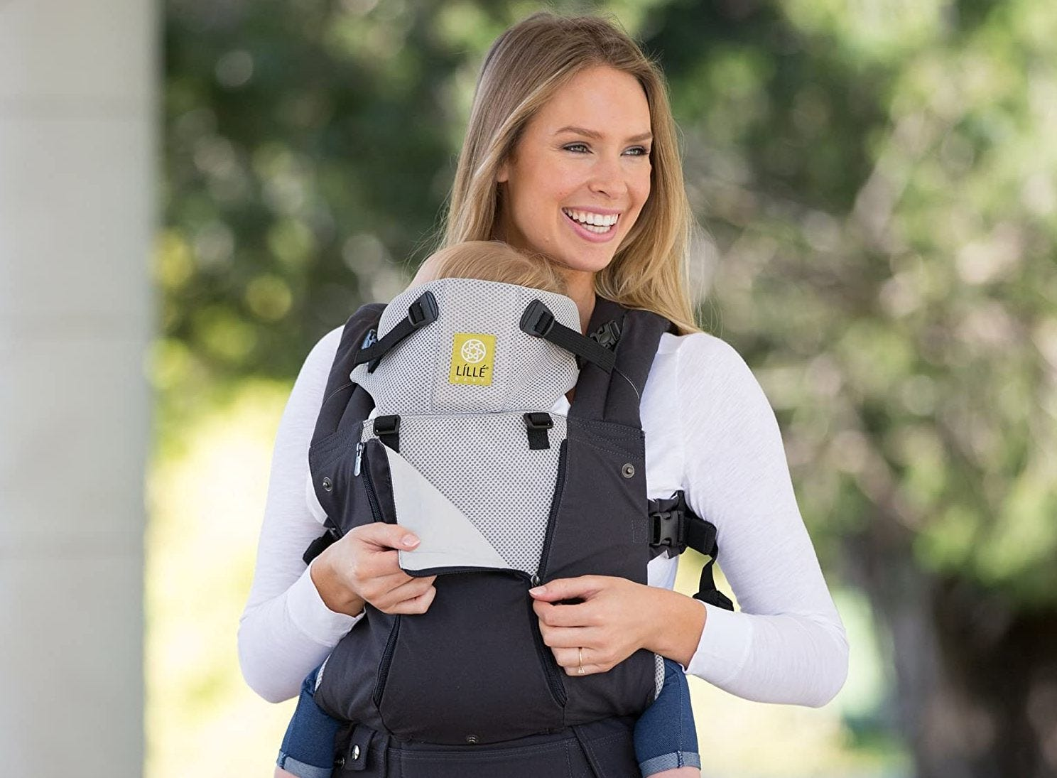 A mom carrying a baby in the LÍLLÉbaby 6-in-1 Carrier.