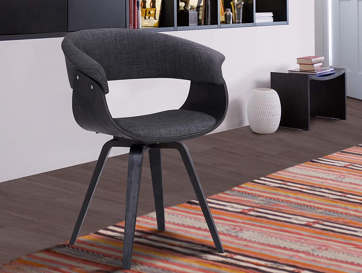 A dark gray bucket-shaped chair with a cutout in the back