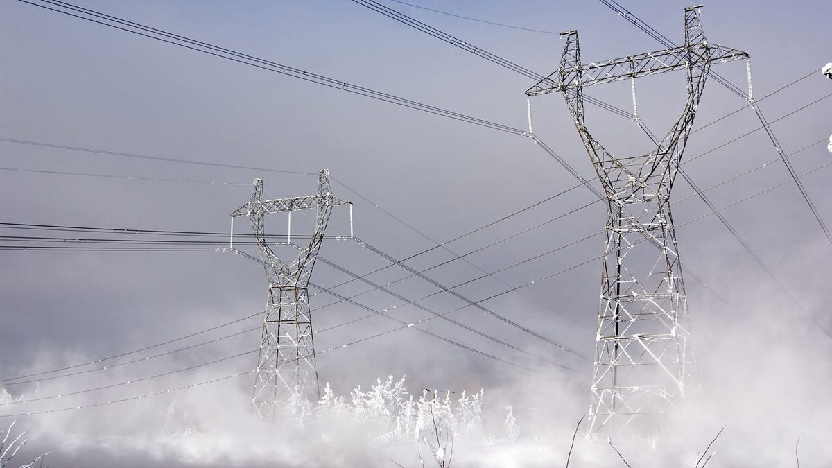 High power transmissions lines during a snowstorm.