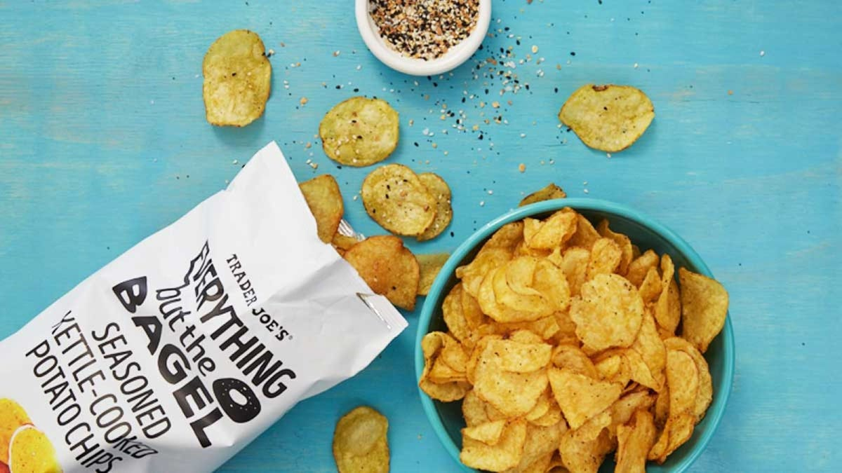 A bag of Everything but the Bagel potato chips spilled out on a counter next to a large bowl full.