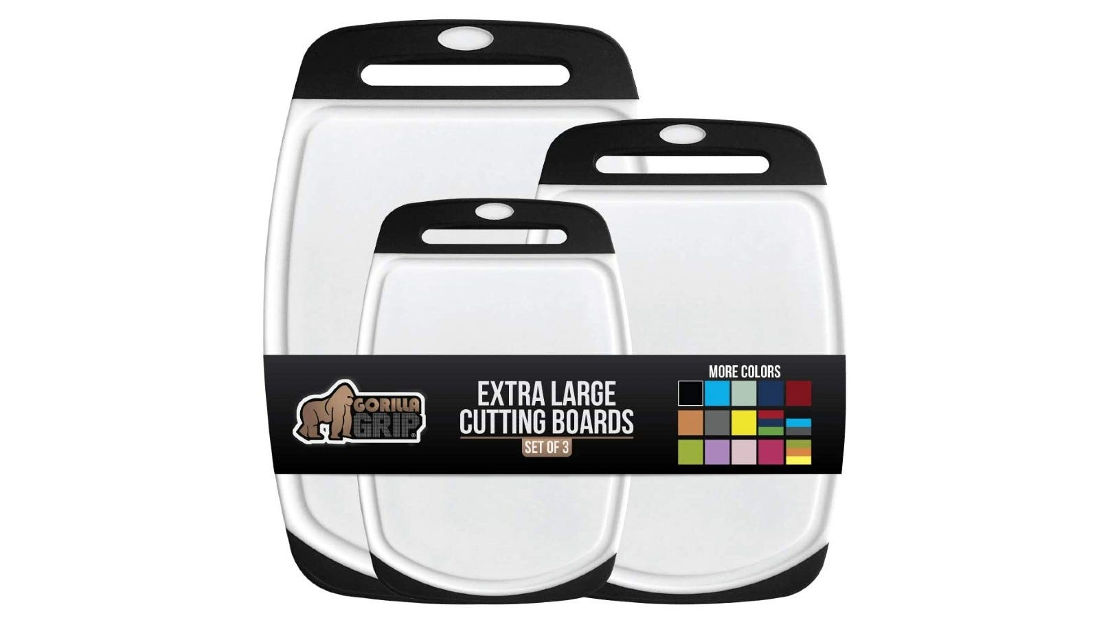three white and black cutting boards