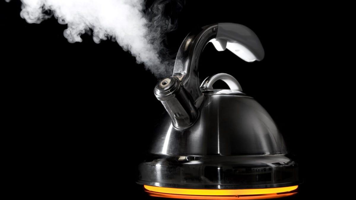 A steaming tea kettle.