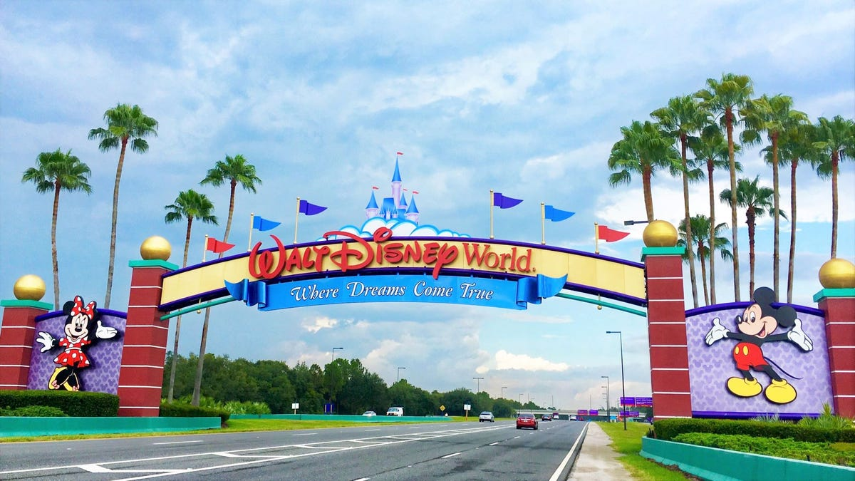 """The """"Where Dreams Come True"""" sign at the entrance of Walt Disney World in Florida."""