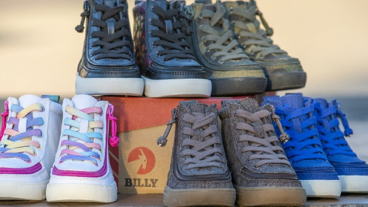 Five pairs of Billy Footwear sneakers in assorted colors and designs, displayed with a Billy Footwear shoebox.