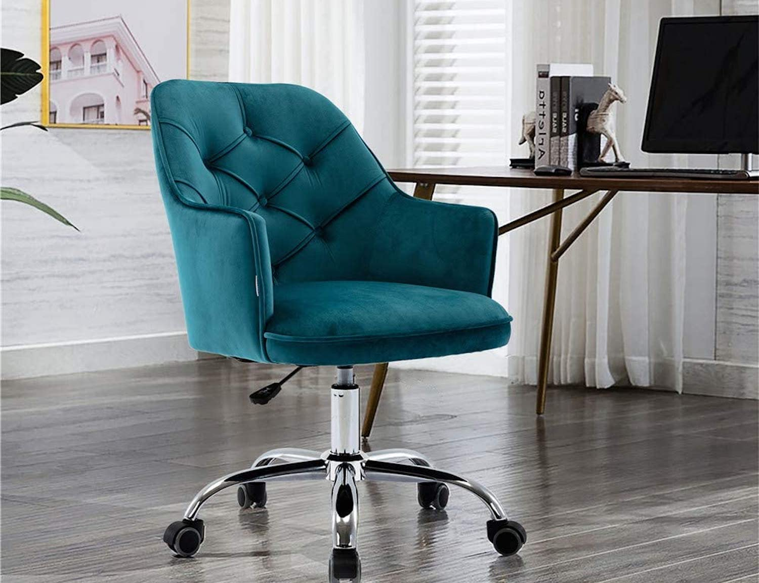 The teal velvet Goujxcy Home Office Chair at a desk.