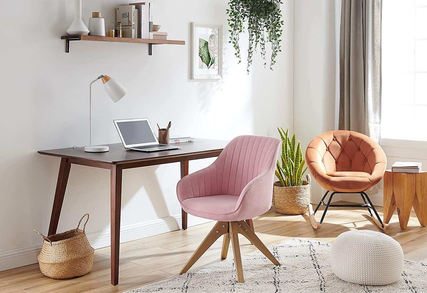 The Art Leon Mid-Century Modern Swivel Accent Chair in Pink-New sitting at a desk.