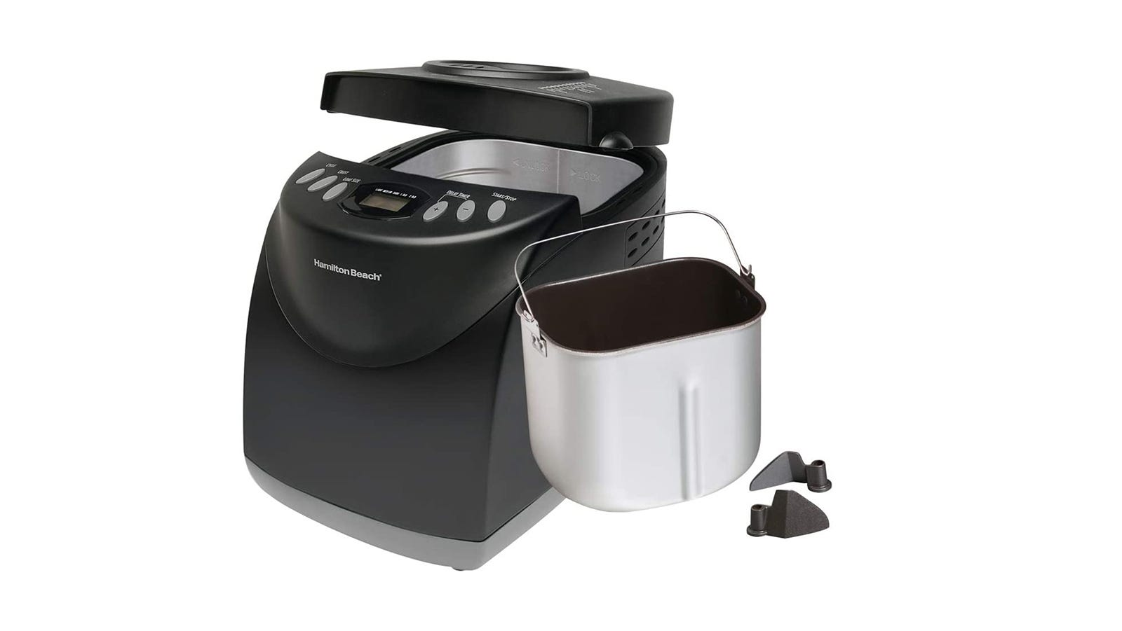 A black bread machine with the silver inner pail sitting next to it
