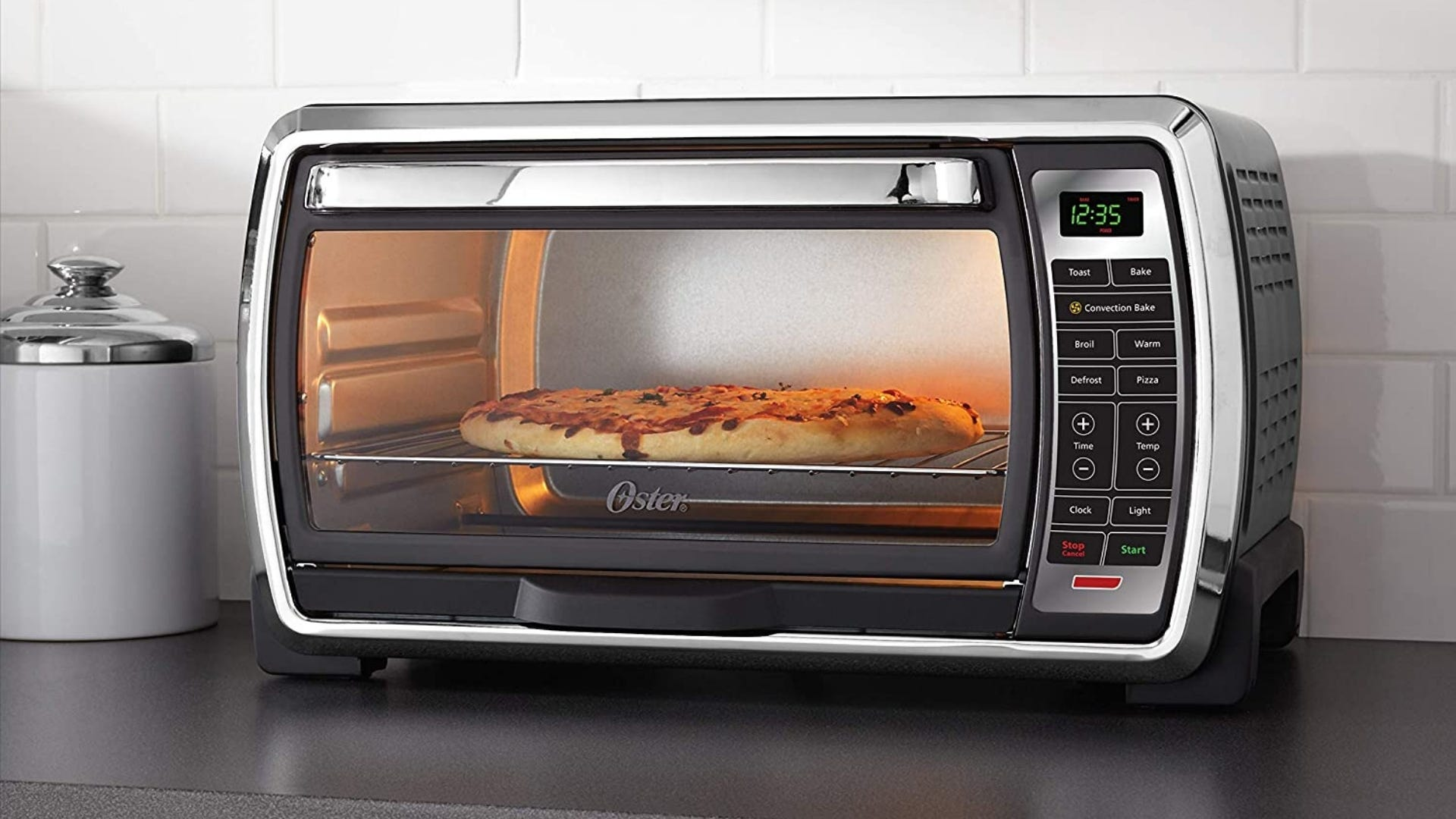 Toaster oven with pizza inside