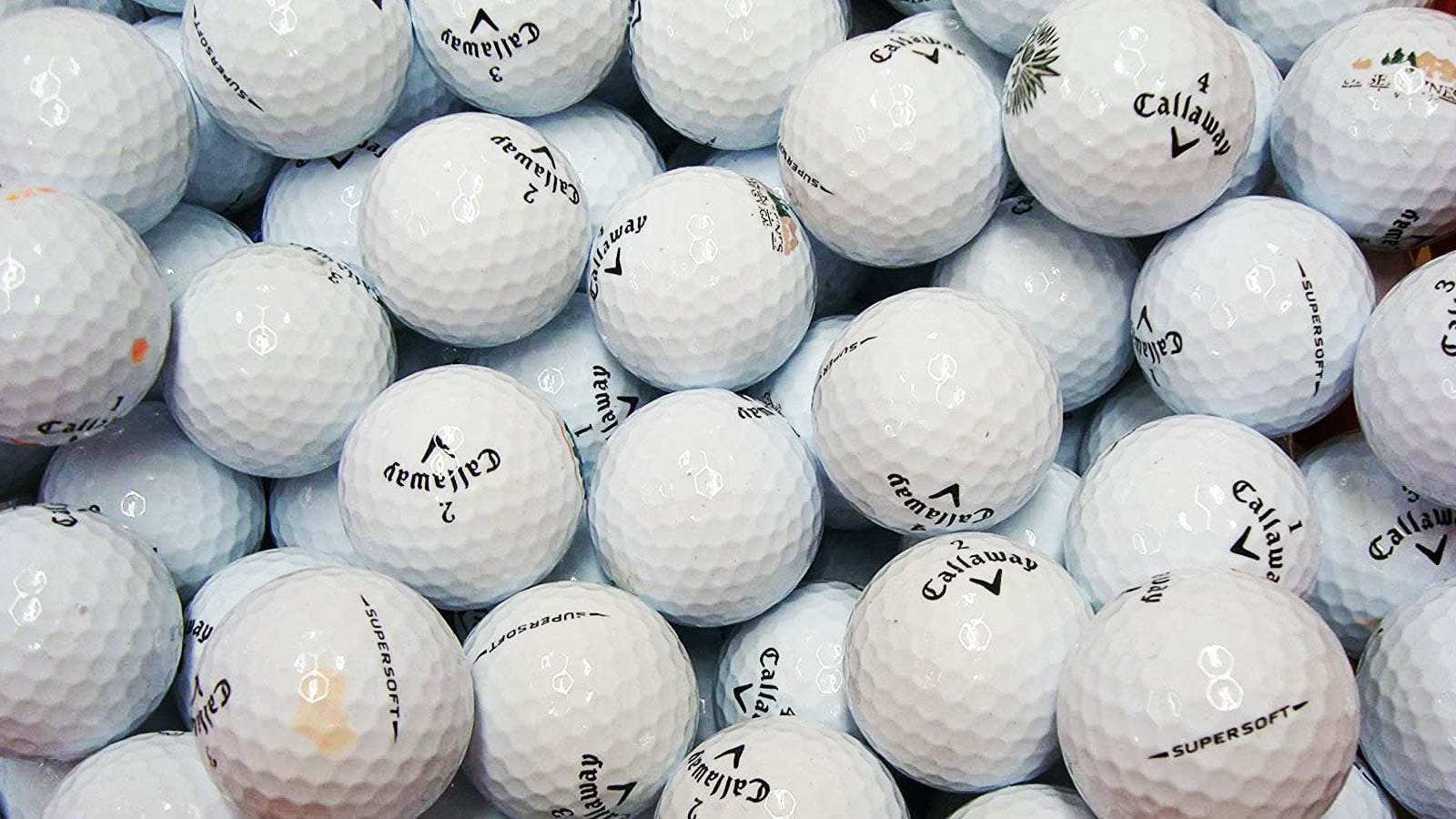 A pile of used Calloway golf balls.