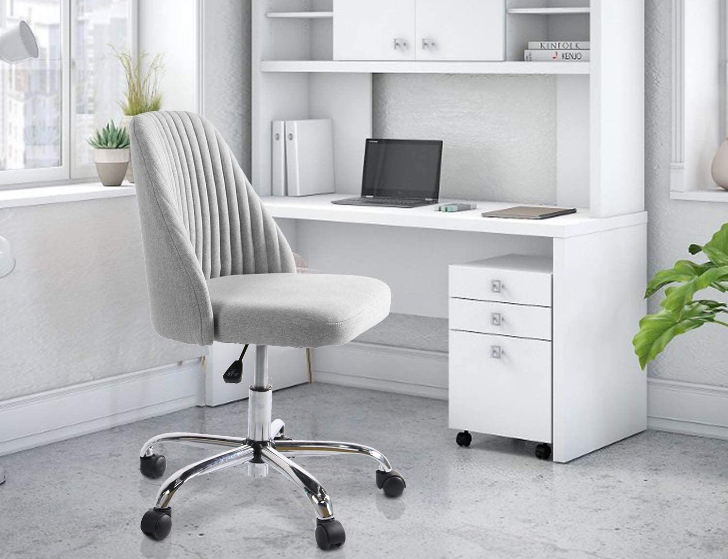 The Rimiking Twill Fabric Chair in Gray in an all-white home office.