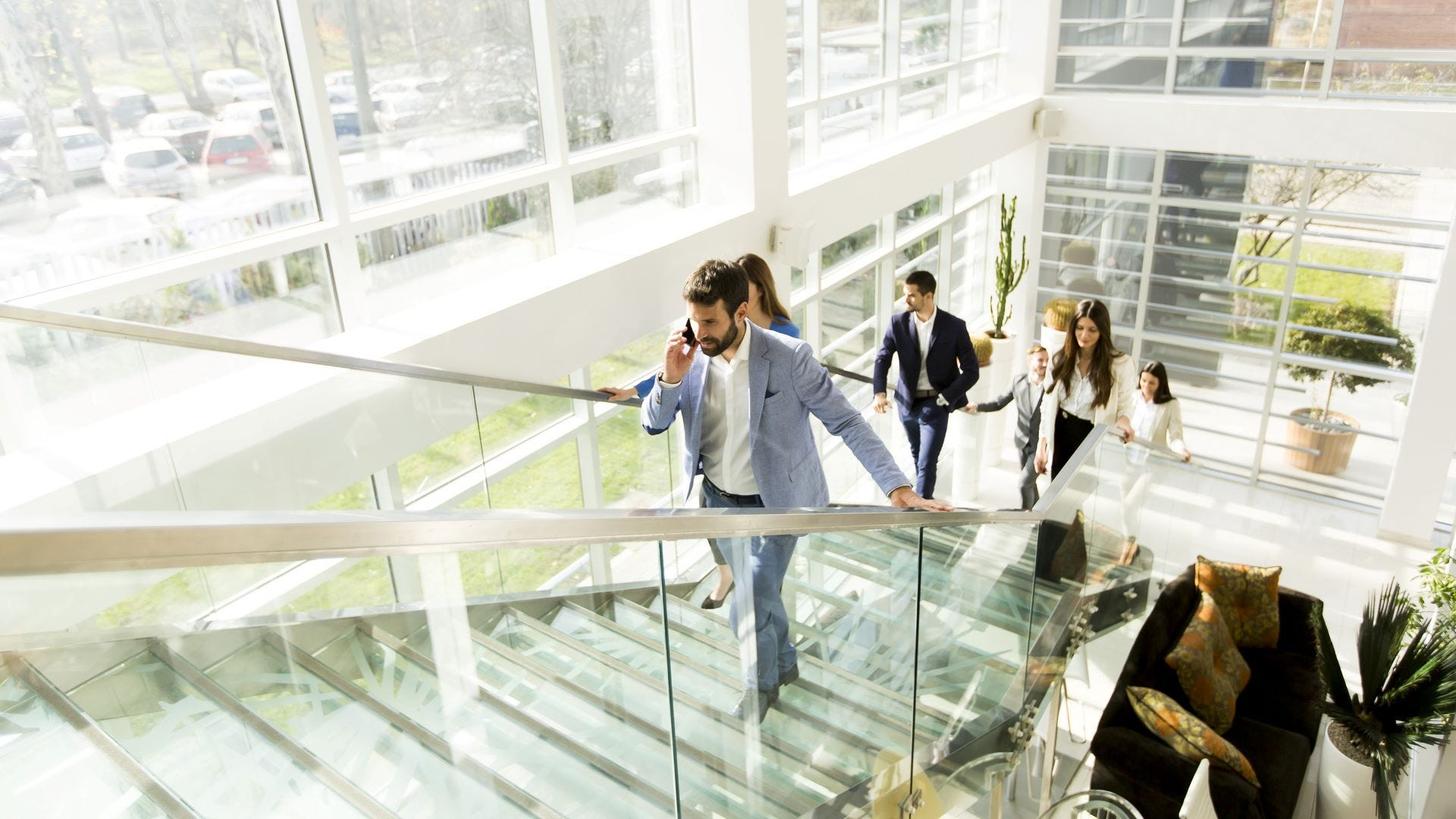 People walking up stairs in an office building.