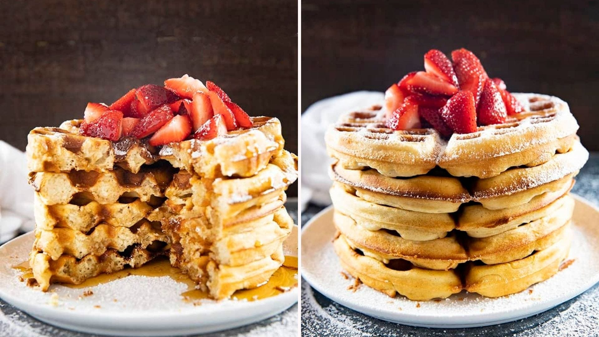 A stack of Belgian waffles with fresh strawberries on top that's been half eaten, next to a fresh, full stack.