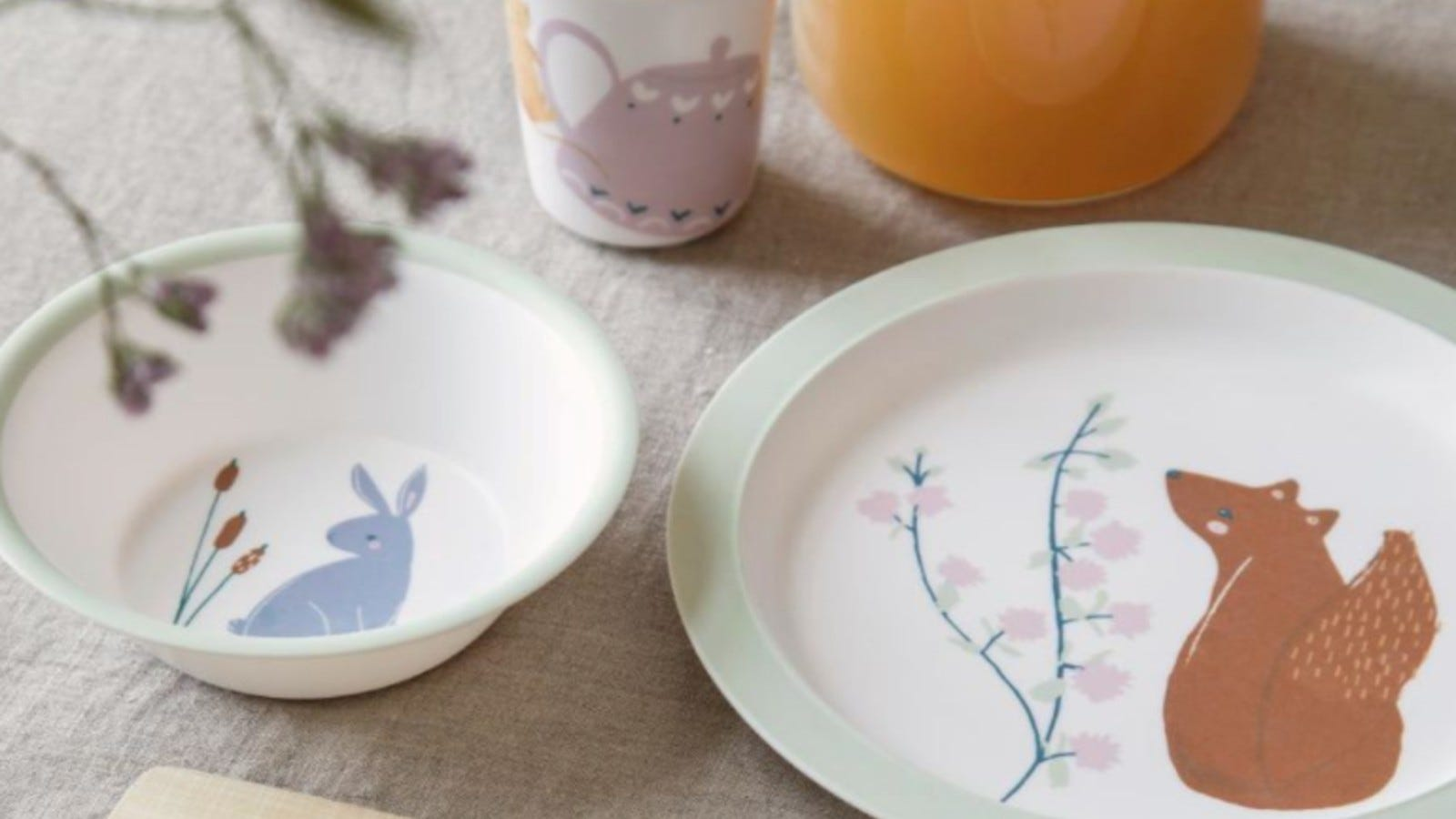 The bowl (featuring a rabbit) and the plate (featuring a squirrel) from the Scandibørn Sebra Tableware Set.