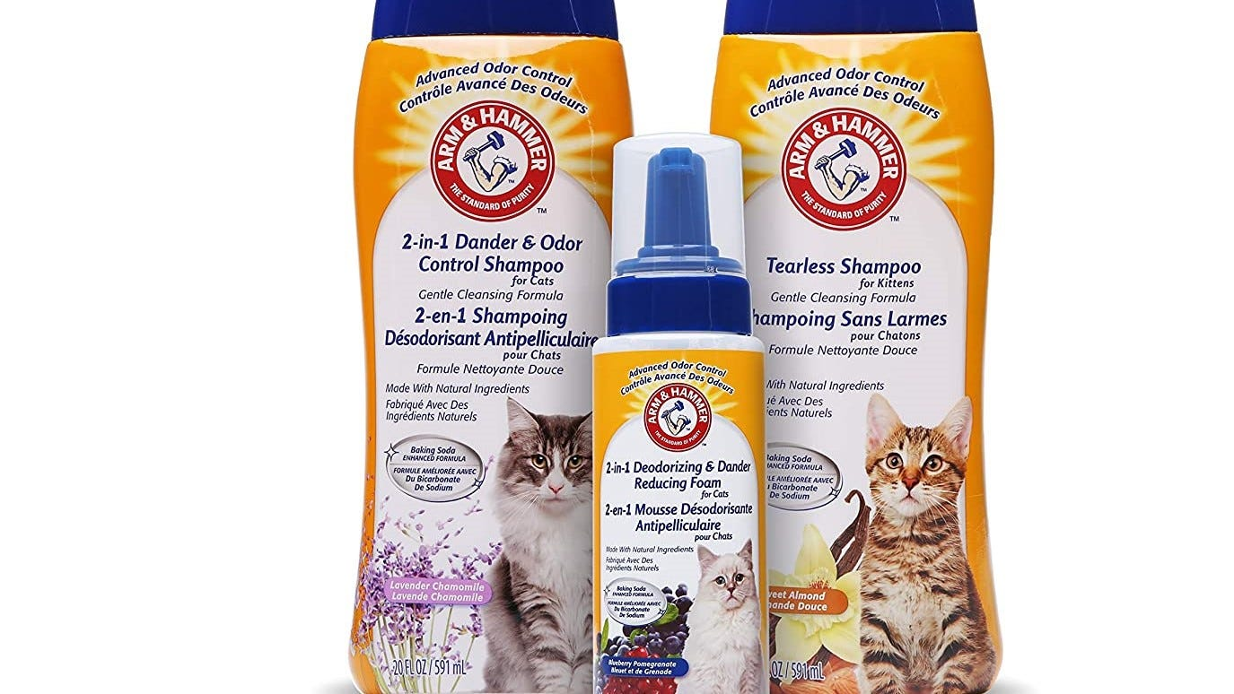Three bottles of Arm & Hammer Two-in-One Cat Shampoo.
