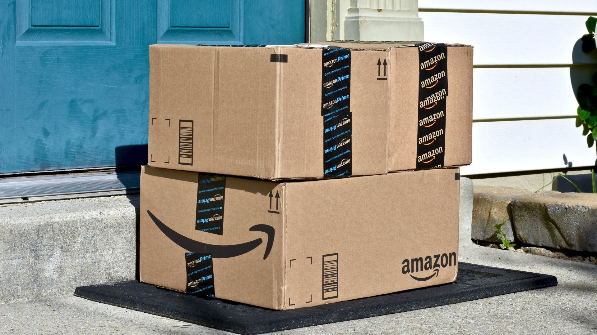 Two Amazon boxes on a porch.