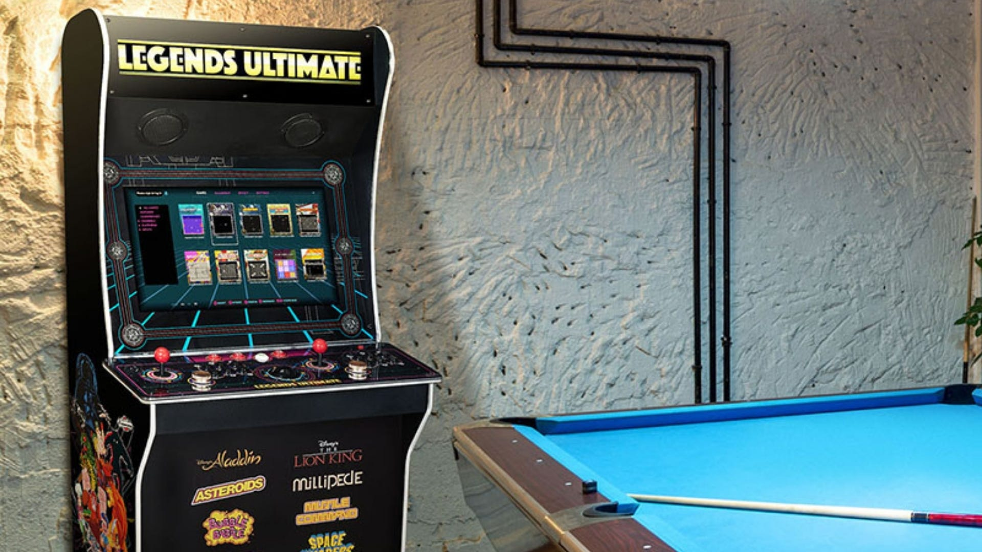 The Legends Ultimate arcade game machine next to a pool table in a game room.