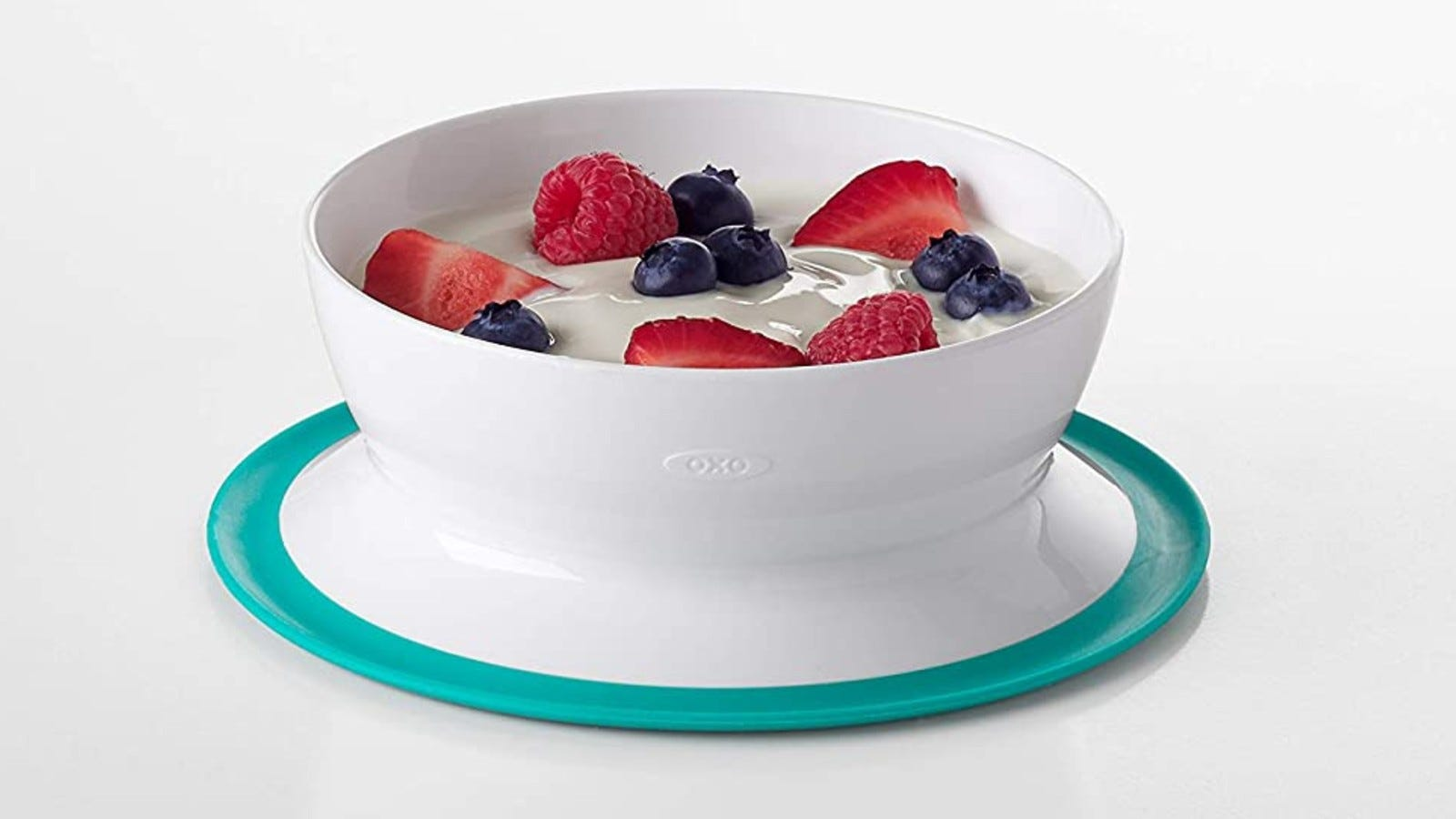 The OXO Tot Stick and Stay bowl filled with yogurt and berries.