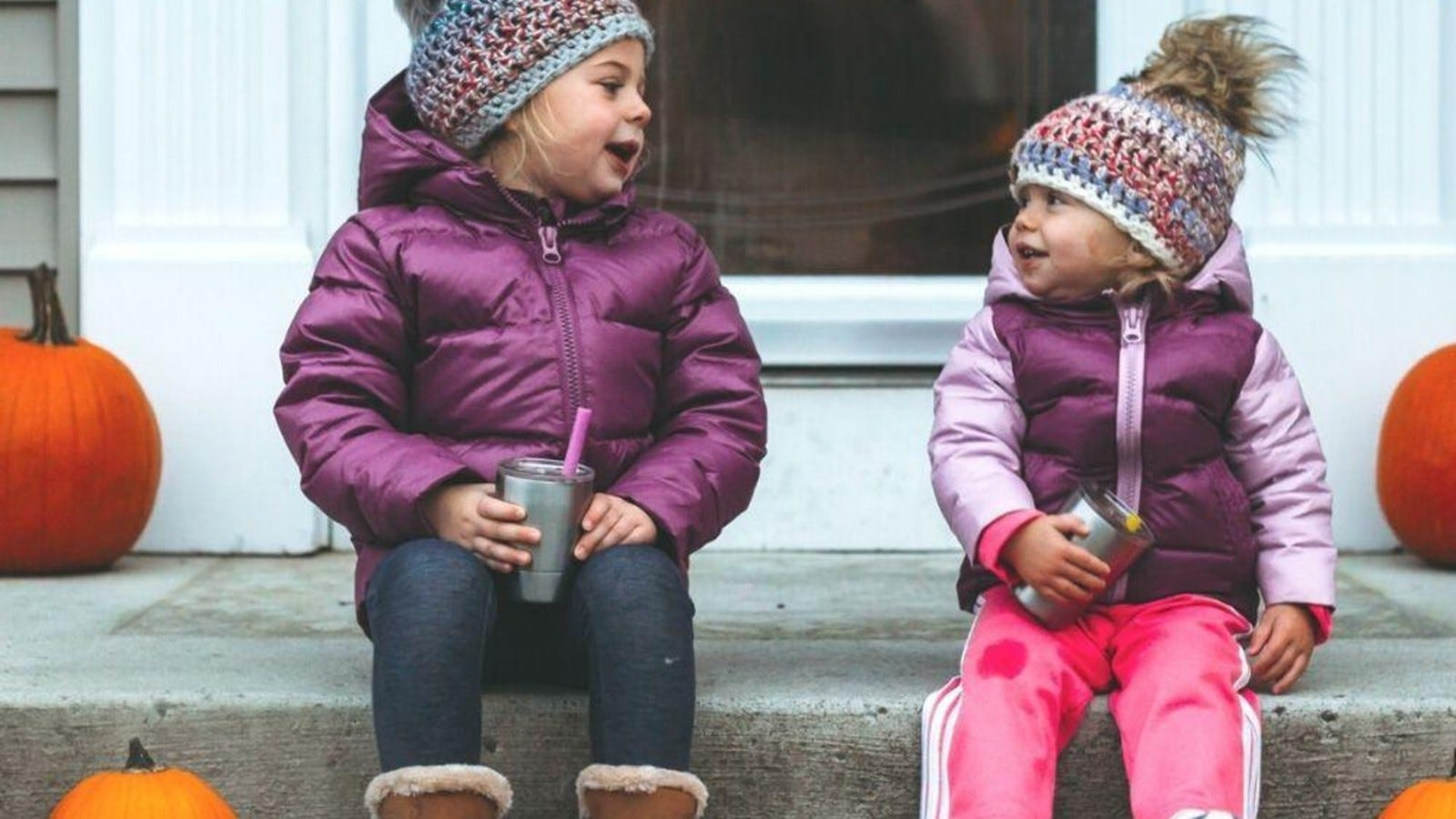 two toddler girls in winter coats