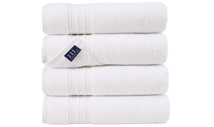 stack of four folded white bath towels