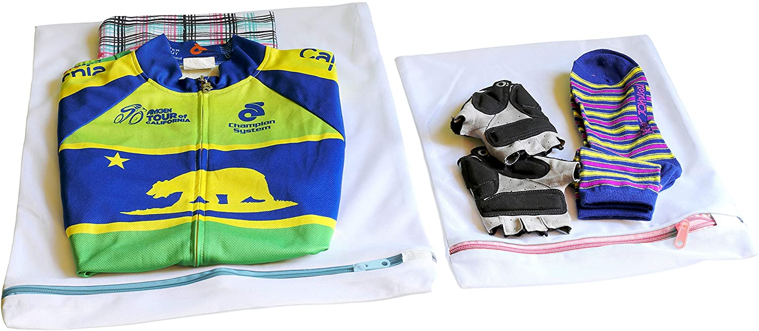 A sports jacket, gloves, and socks sitting on tope of two mesh laundry bags.
