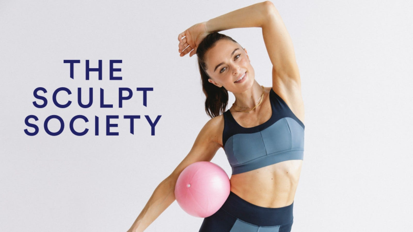 woman in sports bra holding a ball