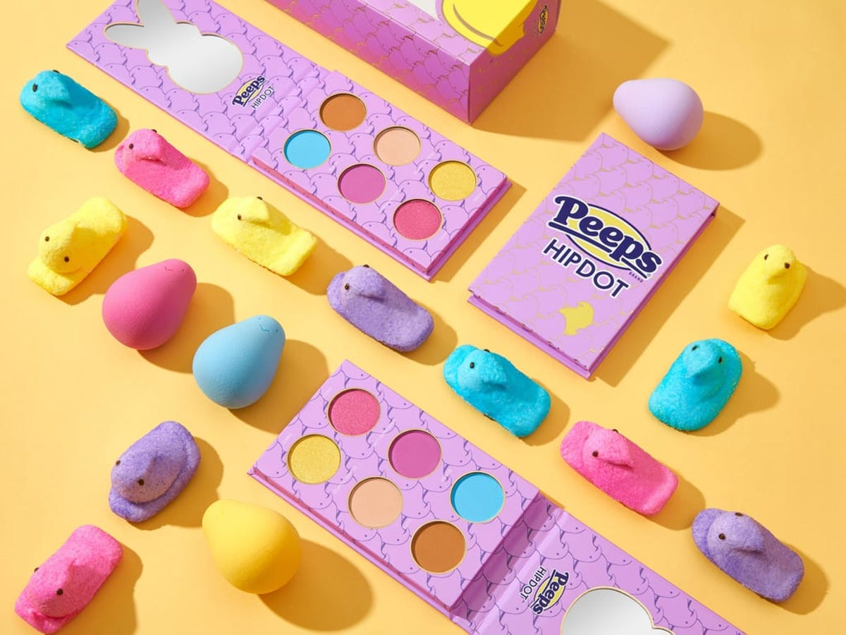 The Peeps HipDot eyeshadow palette surrounded by the candy and matching blending sponges.