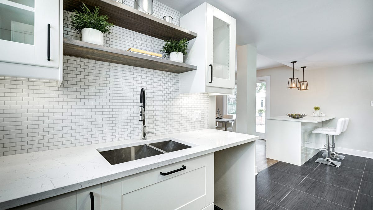Bare and clean counters in a white and modern kitchen.