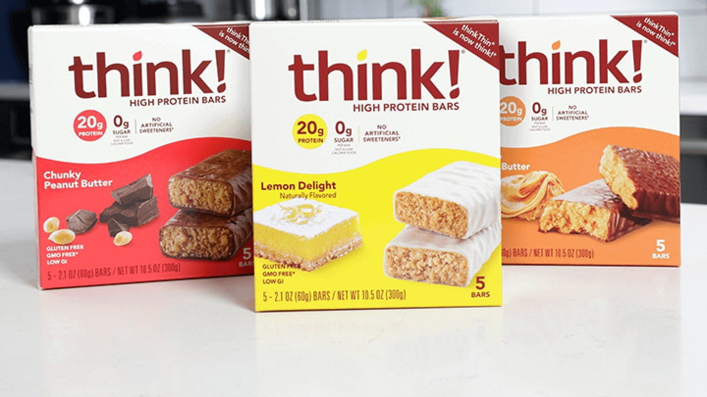 A variety of Think bar boxes on a counter.