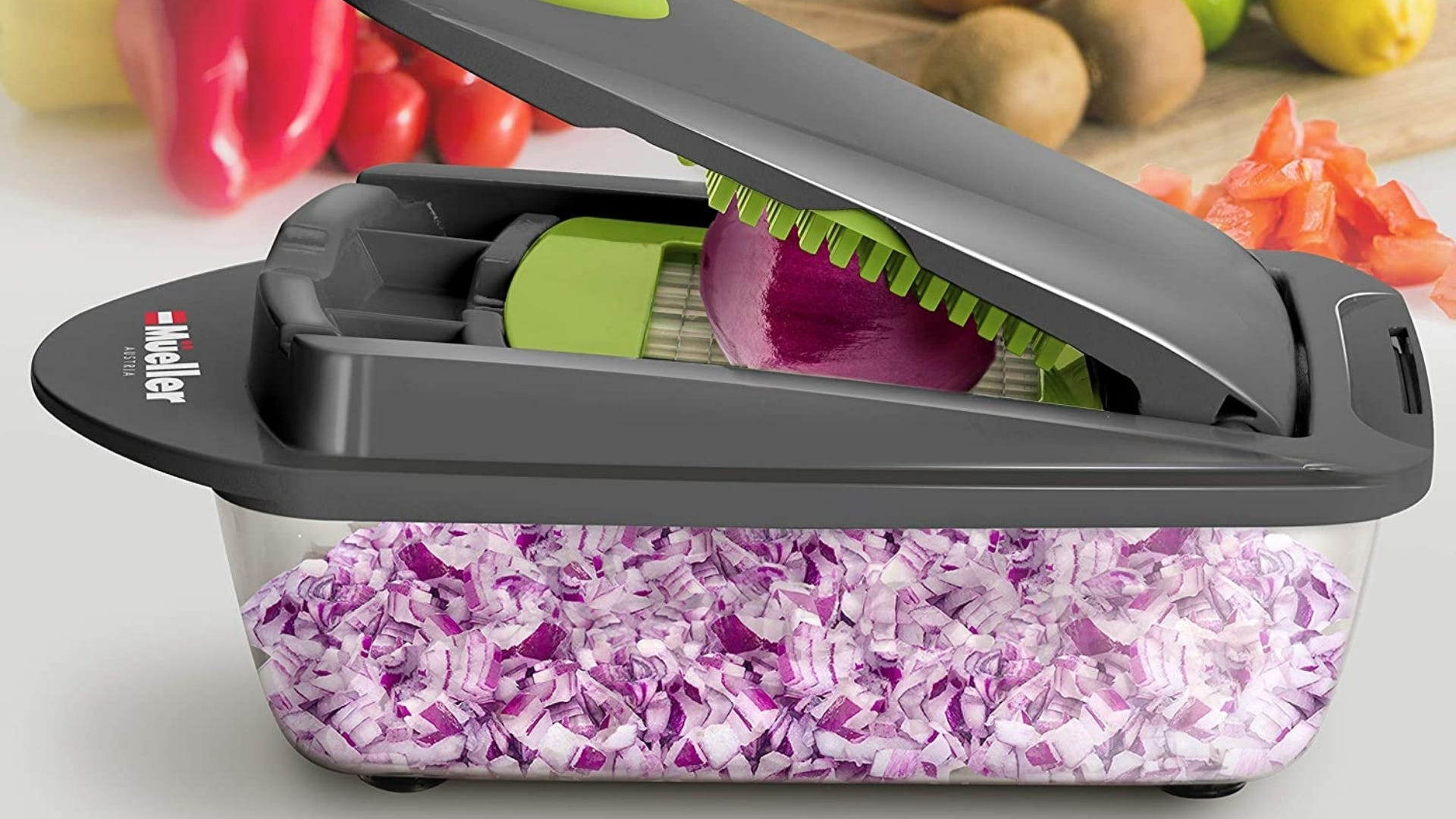 Vegetable chopper cutting up red onion