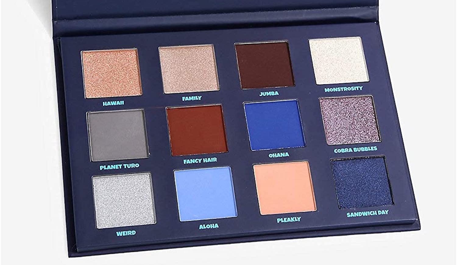 A twelve-section eyeshadow palette in neutrals, blues, and purples