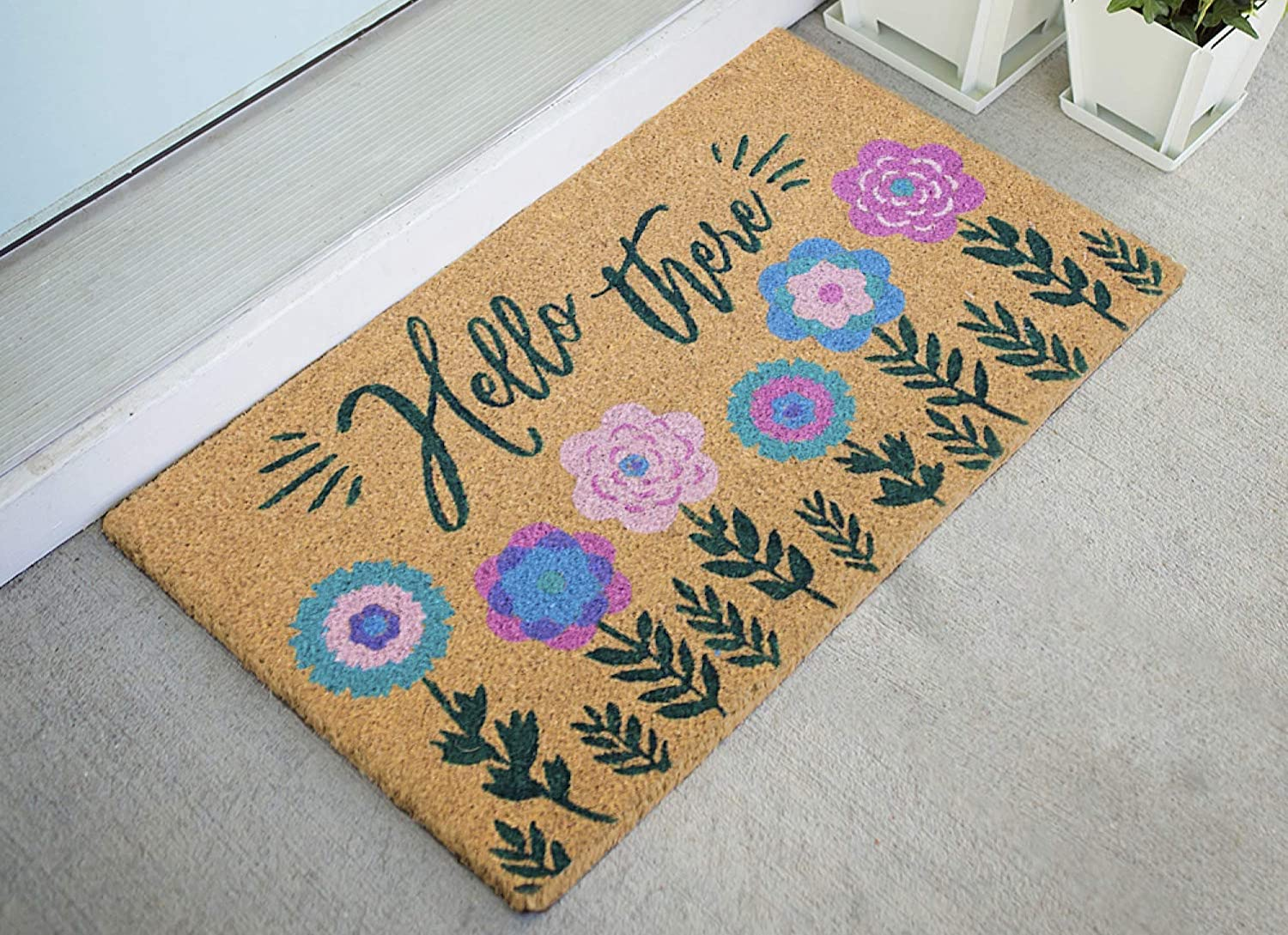 """A welcome mat reading """"hello there"""" in script, with purple and blue flowers along the bottom edge"""