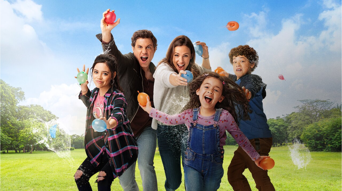"""Jennifer Garner and the cast of """"Yes Day"""" throwing water balloons."""