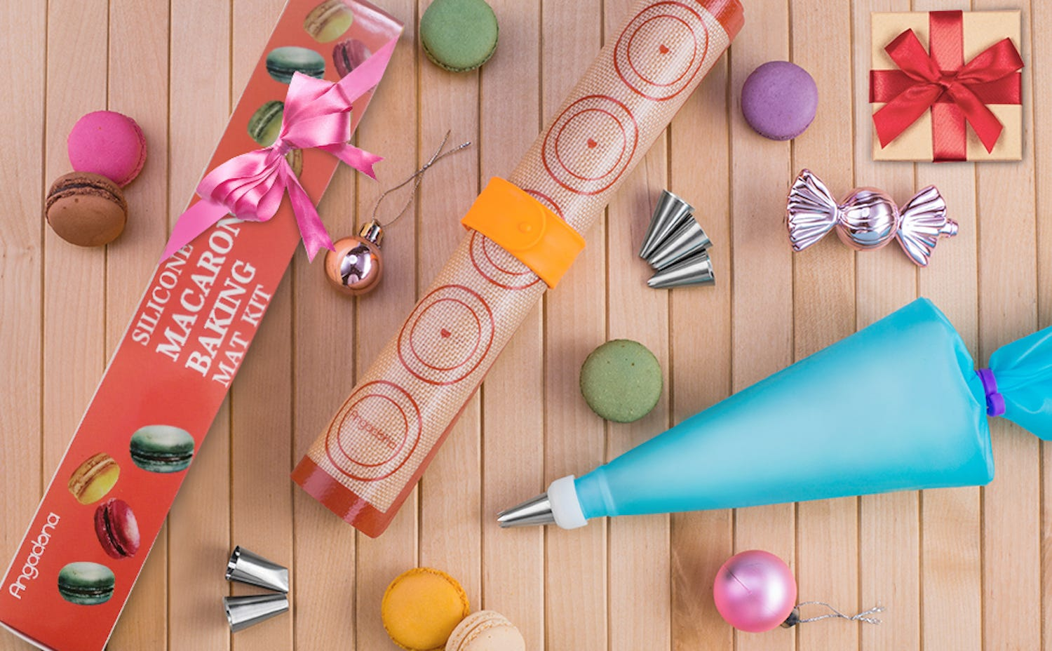 A macaron baking mat, a pastry bag with tip, and several colorful macarons on a wood surface