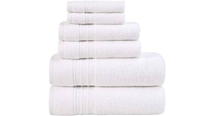 stack of six folded white bath towels