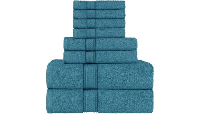 stack of eight folded teal bath towels
