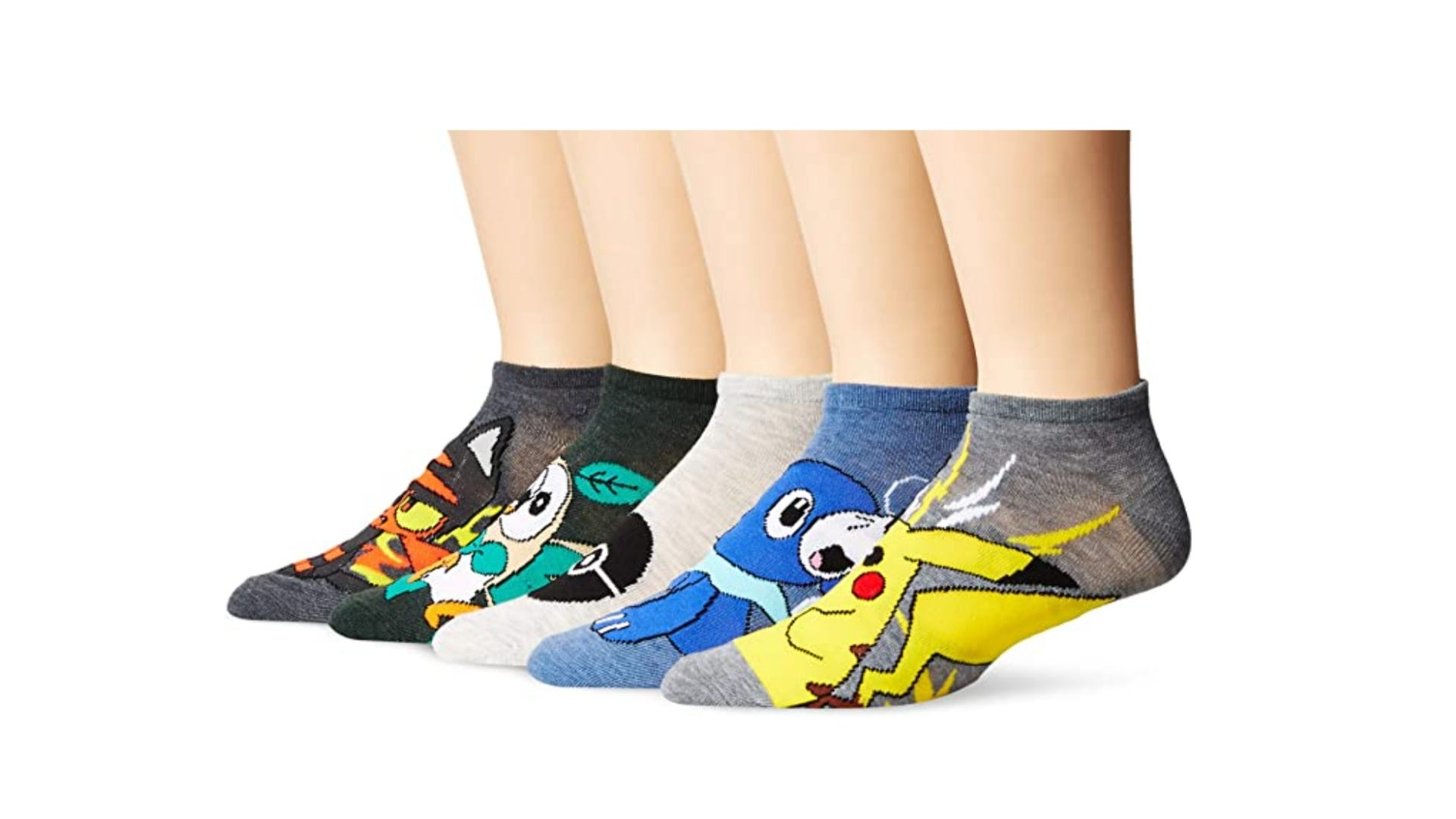 Five pairs of different Pokemon socks being worn.