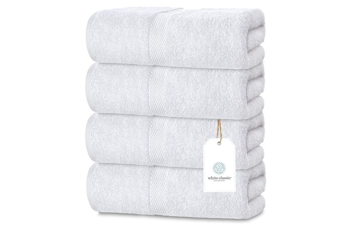 stack of four same-sized, pale gray bath towels