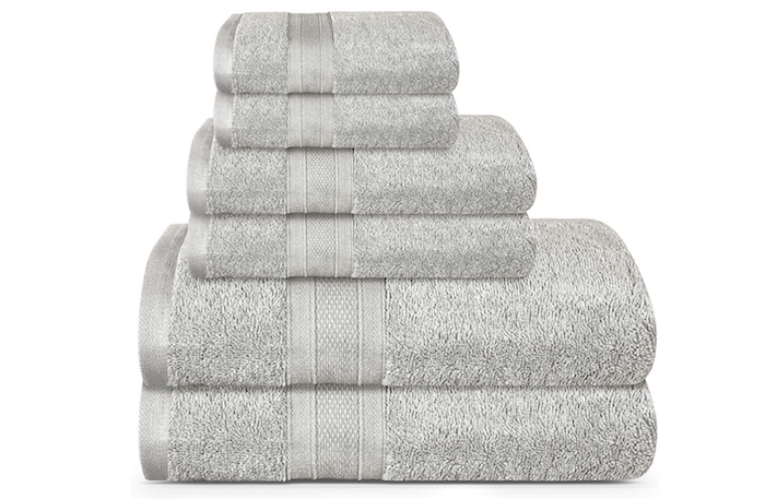 stack of six light gray folded bath towels in three different sizes