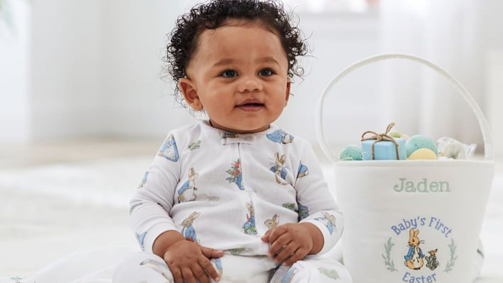 boy in easter pajamas with basket