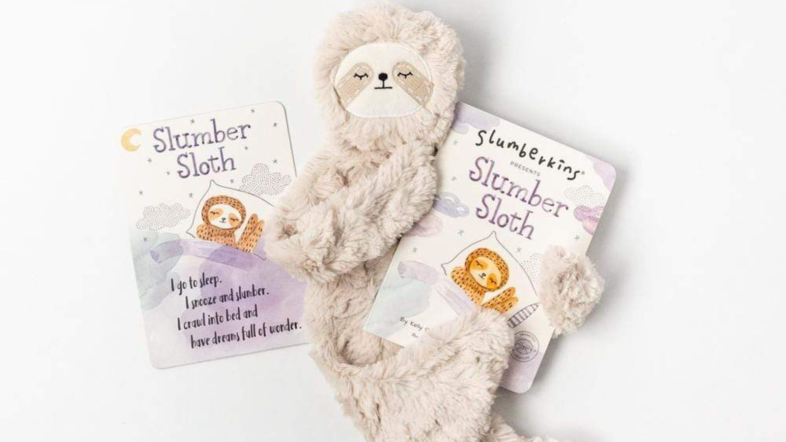 sloth doll with books