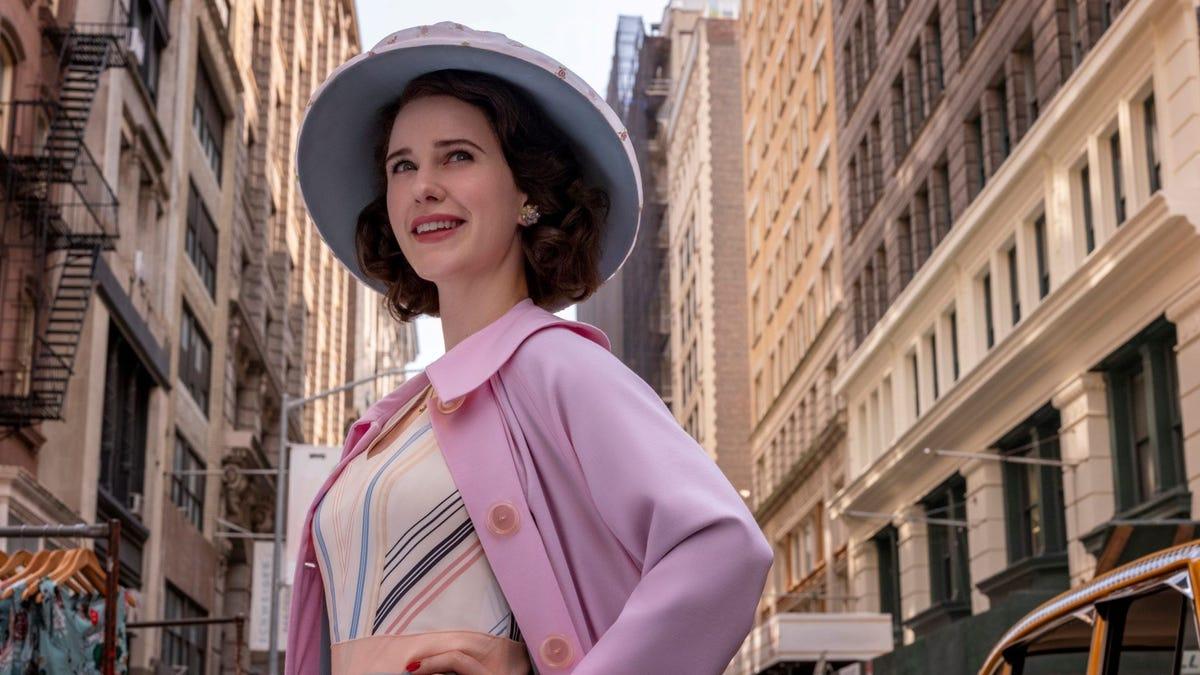 "Rachel Brosnahan as Midge Maisel standing on an NYC street in ""The Marvelous Mrs. Maisel."""