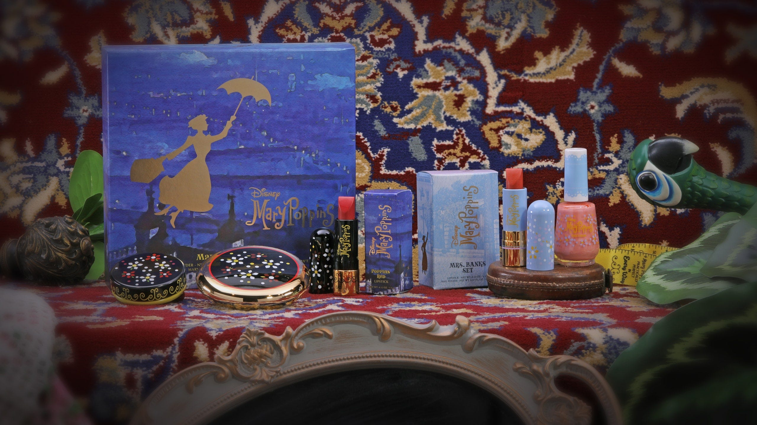 A kit of makeup with compacts and lipsticks against a Mary Poppins artwork