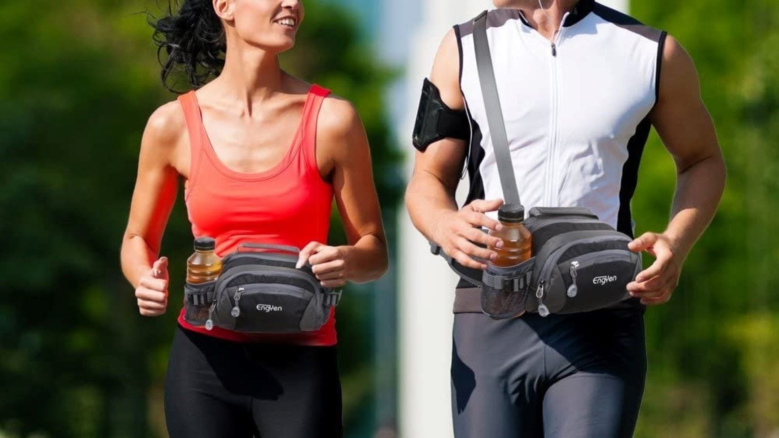 A woman wearing the ENGUYEN Fanny Pack at the waist running with a man wearing the pack as a crossbody bag.