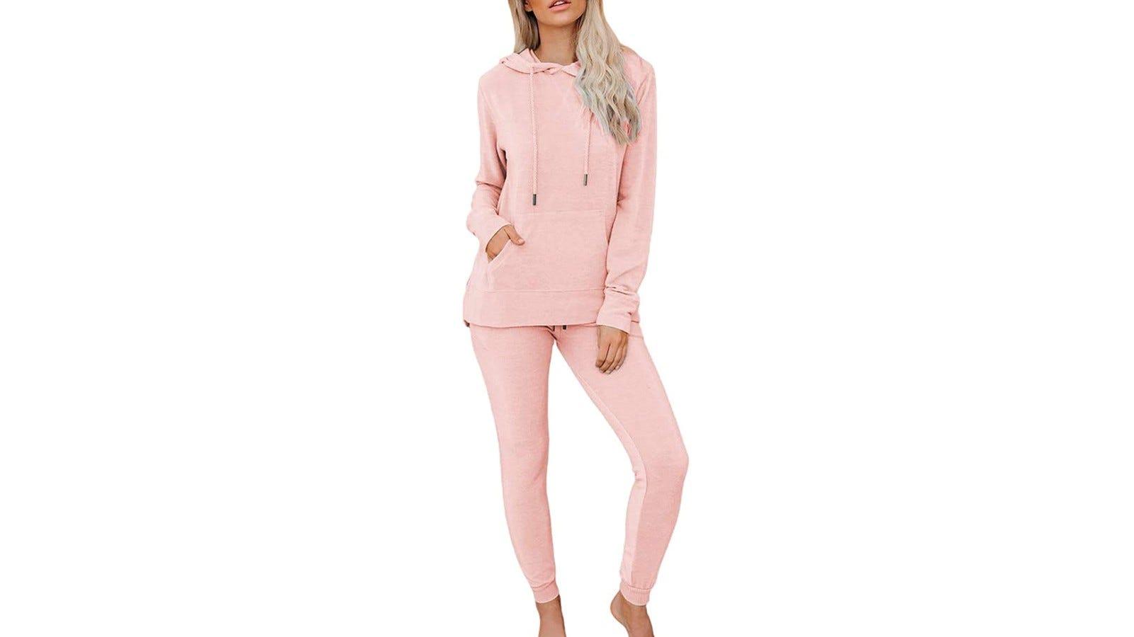 woman wearing light pink sweatsuit
