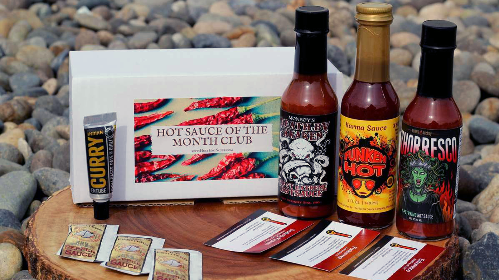 Heat Hot Sauce Shop subscription box with bottles of sauce and information cards