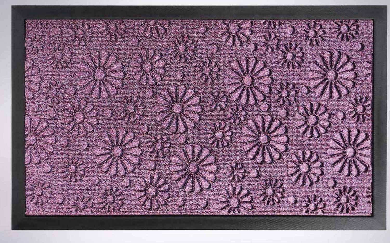 A purple doormat with an embossed daisy pattern